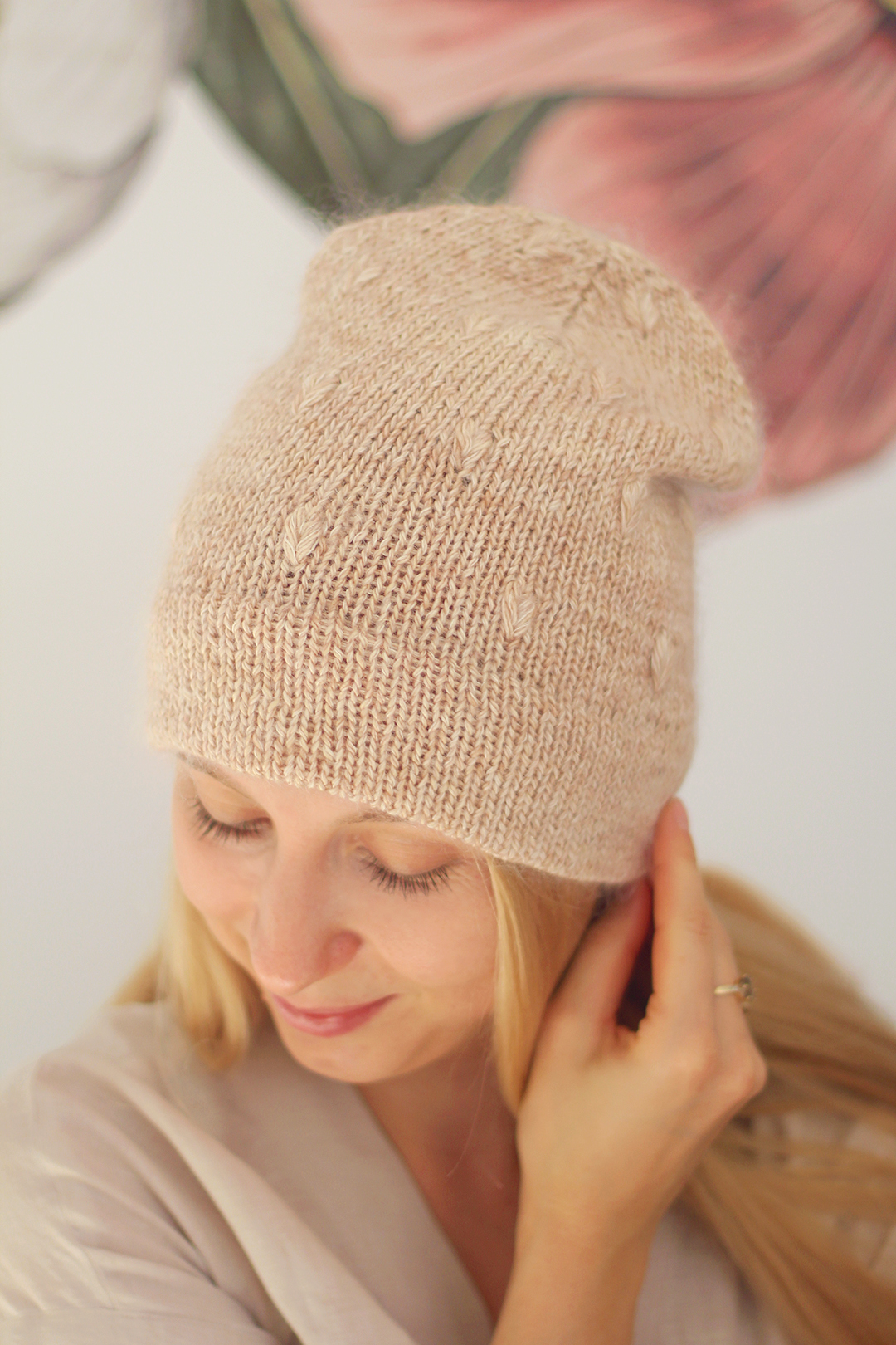 A handmade, knitted hat with a textured stitich pattern