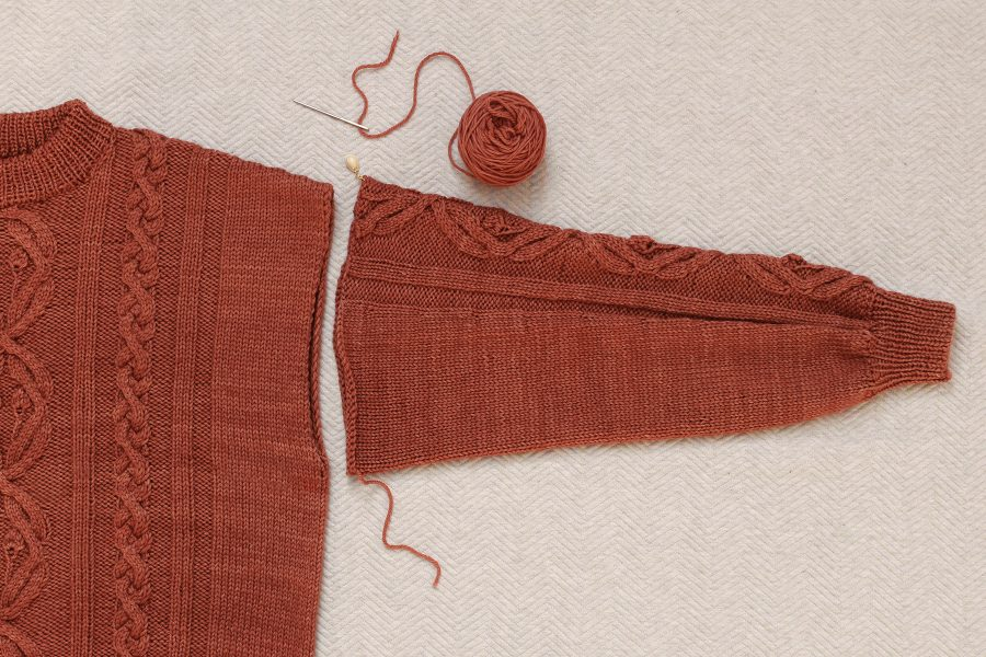 Layout of the sleeve and the body of knitted sweater before sewing